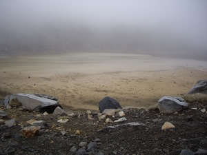 The foggy outline of a lake in the South Crater.