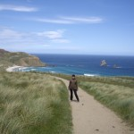 Kenna walking to Sandfly Bay