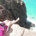 Kenna hanging her feet over the cliff at Indian Head