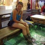 Kenna getting her feet cleaned by fishes