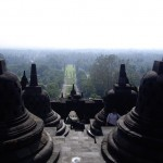 View from the top of Borobudur.  Each bell-shaped thing houses a Buddha.