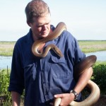 "Our guide holding a ""baby"" python.  This guy will grow to 6m long."
