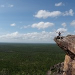 Scott sitting on the edge of a cliff overlooking Kakadu