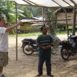 Scott using the blow pipe apparatus. And yes, that man (who is the chief of the village) is really that short.