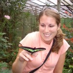 Kenna playing with pretty butterflies