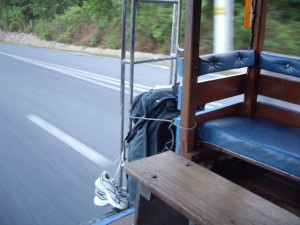 Kenna's bag hanging off the back of the public bus. The bus driver tied it on for her. :)