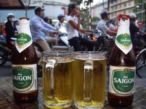 Chilling at a bar drinking $1 Saigon beer, watching the crazy motorcycle traffic of Saigon in front of us.