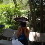 Kenna covering her ears from the blasts of the AK-47's at the Cu Chi tunnels