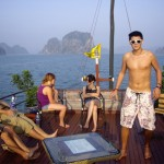 Chilling out on the deck of the boat, with the limestone cliffs of Halong Bay in the distance