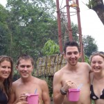 Buckets while tubing in Vang Vieng - a rope swing is behind us