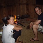 Eveline and Dennis helping our guide, Sakhome cook over an open fire