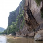 Kayaking beside Limestone cliffs on the Nam Ou river