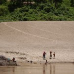 Children playing on the banks of the Mekong