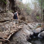 A rickety bamboo bridge at the waterfall