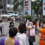 Local Bangkokians taking pictures of the Central World carnage